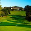 A view of a green and the clubhouse at The Country Club.