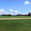 A view of a green protected by a sand trap at Red/Blue Course from Irish Hills Golf & Country Club.