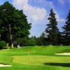 A view of a green protected by sand traps at Conestoga Golf and Country Club
