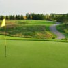 A view of a green with an undulating cart path in background at Nobleton Lakes Golf Club