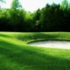 View of the 4th green and bunker at Wellington on the Lake Golf Course