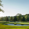 A sunny day view of a hole at Mississaugua Golf and Country Club