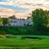 A view of a green and the clubhouse in background at Oshawa Golf Club