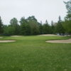 A view of a green surrounded by a collection of bunkers at Mitchell Golf and Country Club