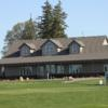 A view of the clubhouse and a tee at Woodstock Meadows Golf Club