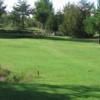 A sunny day view of a tee at Juniper Fairways Golf Club.