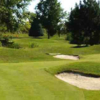 A sunny day view of a green at 18-Hole Putting Course from Rock Chapel Golf Centre.